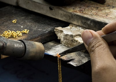 Jeweler Repairing Gold Necklace Chain
